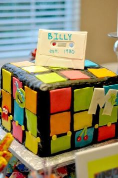 80's theme party! Rubix cube cake, lemonheads, nerds, other 80's candies, 80's music & costumes!