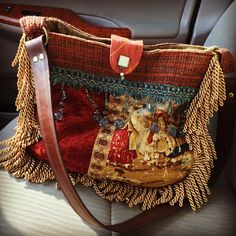 Some fabric remnants, decorative trims, a thrift store belt & some time at my sewing machine=my new favorite vintage/boho/gypsy style shoulder bag made by me;-)
