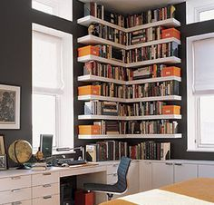 Small corner bookshelves/library. Great use of the space. This look is very eye-catching.
