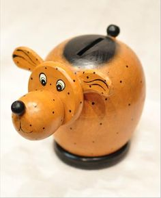 This adorable tail wagging dog bank is hand crafted in Bali and is not mass produced or factory made.
