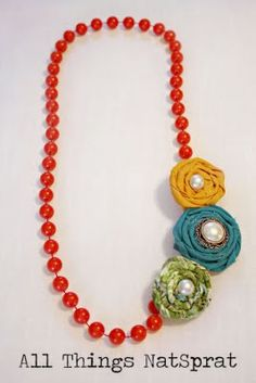 I was looking at some beeds like this at the thrift store. Would of bought them if I saw this way cute rosette necklace before.