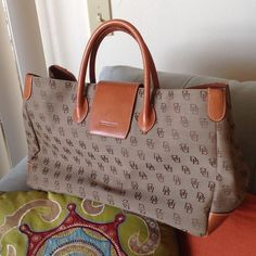 Large and Amazing Dooney Brief! * temp price * Lost my Job and well I will not be needing this, so I have included it in my closet. It's in beautiful shape and very clean, fits legal files and has pockets for everything. Dooney & Bourke Bags