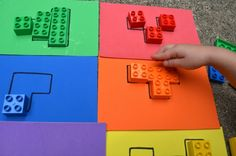 Puzzles and blocks are two things we love, so an activity that combines the two is a sure winner! Plus these puzzles are easy to throw into a bag and bring along as a quiet time activity. (You know how we love our busy bags.) Make Your Block Puzzles colored craft foam sheets (you could also use colored paper) black permanent marker colored blocks LEGO