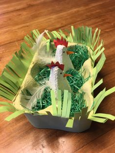 An Easter nest from a lütt egg box. - Basteln mit Kids - An Easter nest from a lütt egg box. Easter Crafts For Kids, Preschool Crafts, Diy For Kids, Easter Art, Easter Eggs, Diy And Crafts, Paper Crafts, Egg Carton Crafts, Easter Baskets