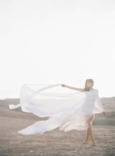 Long and flowing veil in the desert   Styling and Creative Direction : Pearl & Godiva     Photographer : Jen Huang JenHuangPhoto.com