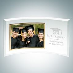Jade Glass Graduation Curved Horizontal Gold Photo Frames. This Gold Horizontal Curved Jade Glass Picture Frame features perfectly beveled edges and is made to outlast the hands of time. Display your Graduation picture proudly or your favorite family photo. It is an ideal gift for Graduations, Anniversaries and Birthdays. Choose a free artwork from our many choices or upload your own logo/artwork file. Engrave your graduating year, university name and your degree to make your