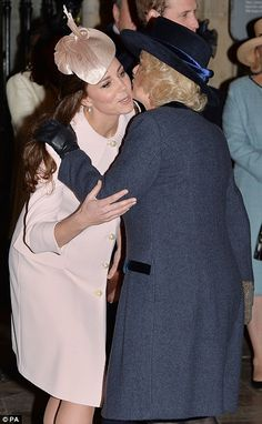 Gathering: The Duchess of Cambridge also traded kisses with Camilla before enjoying a joke with the Prince of Wales