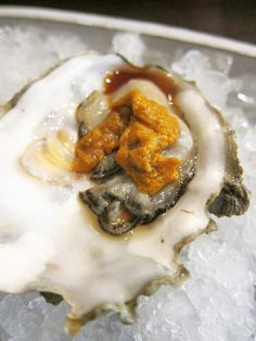 Oyster topped with uni