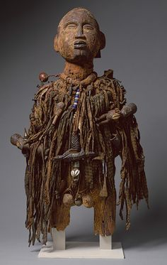 Power Figure (Nkisi), 19th–20th century Kongo peoples; Democratic Republic of Congo Wood, paint, nails, cloth, beads, shells, arrows, leather, nuts, twine