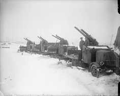 MINISTRY INFORMATION FIRST WORLD WAR OFFICIAL COLLECTION (Q 4703)   Four 13 pdr. 9 cwt motor anti-aircraft guns in the snow. Outside Arras, February 1917.