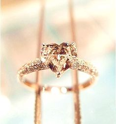 Heart-shaped Diamond Ring. Look familiar? Ooooohh it would be so cute if your wedding or engagement ring was like this