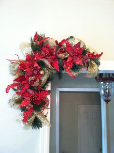 Red Poinsettia & Pomegranate Door Frame Christmas Swags with metallic gold deco mesh ribbon by Greatwood Floral Designs.