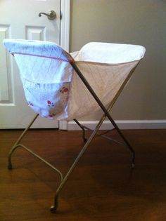 I was getting clothes off the line today, and the smell suddenly made me remember Mama's laundry cart she used when she hung out the clothes. (I hadn't thought of it in forever.) One just like this--Antique Vintage Fold Up Laundry Cart by Vintagecollectorlove, $48.00