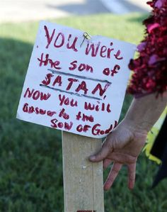 A sign and a flag is placed at a make-shift memorial outside a military recruiting center on Friday, July 17, 2015, in Chattanooga, Tenn. Mohammad Youssef Abdulazeez of Hixson, Tenn., attacked two military facilities on Thursday, in a shooting rampage that killed four Marines. (AP Photo/John Bazemore) Photo by Associated Press /Times Free Press.
