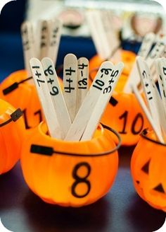 These look fun . . each number bond on a lolly pop stick and placed in the right tub. Great game !