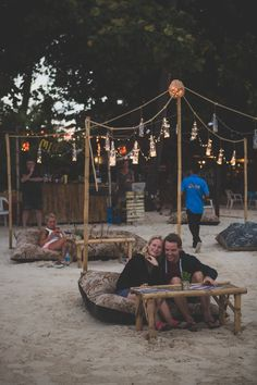 Romantic couple on a beanbag on the beach at Mini Bar, Chaweng Beach, Koh Samui…