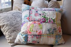 vintage hankies I think. And I have that other fabric! I like these pillows.
