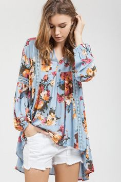 Florals are a big trend this season and this one is one of the best floral prints. Gold and garnet flowers on field of blue this tunic style top is too cute and an easy fit .
