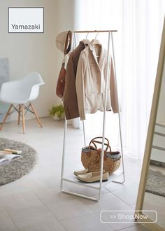 This slim, cleverly designed freestanding hanger rack is the perfect way to increase storage space in any home. Shelf at the base for holding shoes, purses, or other bulky items. It can be used to hang coats and outerwear, or clothes that need to dry after a wash. Extra pole space at the ends designed to increase hanging potential. Wardrobe Solutions, Shelves, Hamper Storage, Hanging Racks, Storage Spaces, Hanger Rack, Loft Conversion Wardrobes, Rack, Coat Stands
