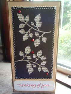 neat way to use the negative of a die cut; using old book pages behind--- for cards