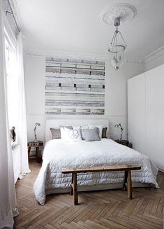 Small Scandinavian bedroom with wooden floor