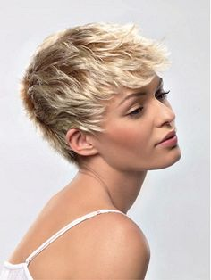 A short blonde straight choppy hairstyle by Estetica