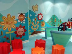 The entry room of the 'It's a Small World' Nursery reflects the whimsical nature of the theme park attraction. Photo by Mark Goldhaber.