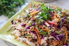 A healthy Asian Chicken Slaw made with a variety of fresh vegetables and a peanut butter soy sauce dressing making for a delicious and easy meal
