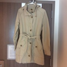 Gap trench coat  This is a very functional fall coat. I purchase it and never wore it. It has a detachable hoodie. The hoodie is attached by a zipper. It also has zipper and bottom closure in the front and pockets on the side. The color will match with pretty much everything you have in your closet. GAP Jackets & Coats Trench Coats