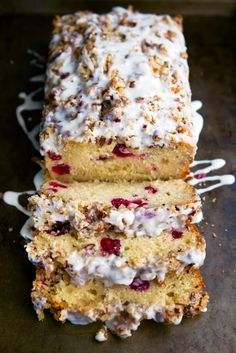 amazing, must try white chocolate cranberry loaf; moist loaf cake made with melted white chocolate, cranberries, yogurt and oil for moistness and richness; topped with a buttery pecan streusel and a white chocolate drizzle