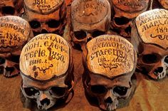 Dated skulls, Romania - The skulls in the ossuary of the 15th century Neamt Monastery bear little texts stating the names and dates of the monks. Photo Mick Palarczyk.