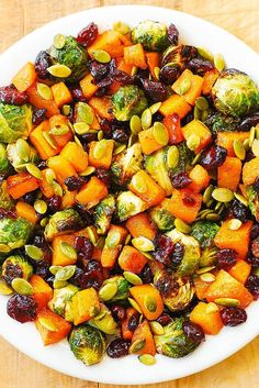 Maple Butternut Squash, Roasted Brussels Sprouts, Pumpkin Seeds, and Cranberries – perfect Autumn salad, bursting with colors and flavors! I love this reci Sprouts Salad, Brussel Sprout Salad, Brussels Sprouts, Vegan Brussel Sprout Recipes, Butternut Squash And Brussel Sprouts Recipe, Vegan Butternut Squash Recipes, Pumpkin Seed Recipes, Vegetable Dishes, Vegetable Recipes