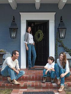 Red brick, blue exterior paint color, white trim