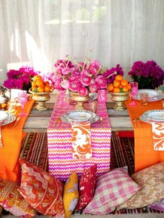 orange and fuchsia table cloth runners