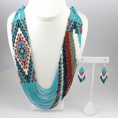 Rena Charles, Multiple Strand Glass Beaded Necklace with a Navajo Rug Design and Matching Sterling Silver French Hook Earrings.