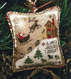 """From Homespun Elegance is this cross stitch Christmas Ornament pattern titled """"Santa Arrives Tonight"""" that is stiched with Gentle Art Sample..."""