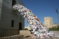 """Alicia Martin's installment of """"Bibliografias"""" -- books literally spilling out of windows in Spain."""