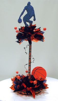 Basketball Having a Ball Centerpiece Kit. Order in your team colors. It's easy to make your own table decorations for Bar Mitzvah, School Banquets or Sports Theme parties. No need to hire a decorator! http://www.awesomeevent.com/tall-bar-mitzvah-centerpieces/basketball.aspx