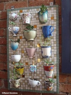 Reuse the broken teacups to make a mosaic board