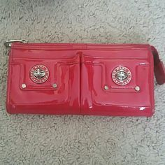 Authentic Red Marc by Marc Jacobs wallet Red Marc by Marc Jacobs wallet. This was bought from bloomingdales. There is some cracking on the front and back but the price reflects. There is still life in this wallet! Sorry no trades Marc by Marc Jacobs Bags Wallets