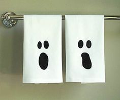 Ghostly Tea Towels - Your guests will get a surprise scare with these haunting bathroom towels. What you'll need: white hand towels, ghost template, painter's tape, craft knife, freezer paper (found at the grocery store), iron, black fabric paint, foam or stencil brush, scrap cardboard or plastic.