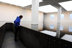 Richard Wilson 20:50: A visitor peers into the oily reservoir