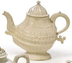 RARE STAFFORDSHIRE WHITE SALT-GLAZED STONEWARE COMMEMORATIVE TEAPOT AND COVER CIRCA 1740-50