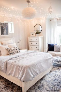 Winter Wonderland Bedroom Refresh using baby blue and white with icicle lights hanging from the ceiling! #winterdecor #bedroomdecor #girlsbedroom