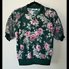 A very different piece. .. floral print dark green shirt at https://www.etsy.com/listing/206320286/90s-floral-print-with-mesh-collared-crop