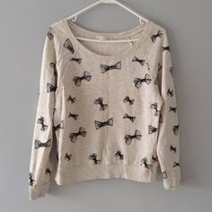 Off The Shoulder Bow Sweatshirt Adorable long sleeve light grey sweatshirt. Can be worn off the shoulder. Has a slight stain on the back (in third photo) can barely be seen. Forever 21 Tops Sweatshirts & Hoodies