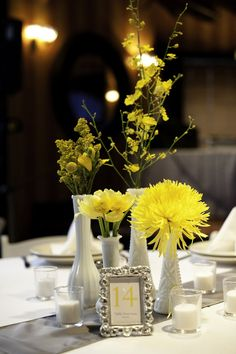 Yellow and Grey wedding - this entire post has some great ideas to tie in yellow without overdoing it - coral instead of yellow...