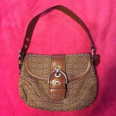 Coach purse Authentic coach purse! Used couple of times. Still in perfect condition! Only problem is I dropped super glue on it.. But I'm sure it can be fixed. Everything else is good other than that Coach Bags Mini Bags