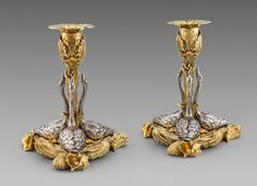 A pair of William IV silver & parcel-gilt swan Candlesticks, London 1830, Maker's mark of John Bridge. Both stamped with the royal retailers mark of 'Rundell Bridge & Rundell Aurifices Regis Londoni' The cast shaped-triangular bases with shell corners and with three applied swans. With central foliage stems, berried and foliage capitals and detachable petal sconces.