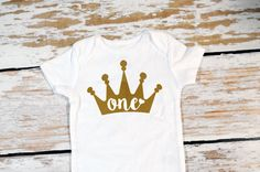 A personal favorite from my Etsy shop https://www.etsy.com/listing/456701894/one-with-heart-in-crown-onesie-first